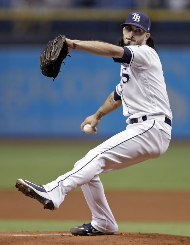 Tampa Bay Rays' Hunter Wood goes into his windup against the Kansas City Royals during the first inning of a baseball game Monday, Aug. 20, 2018, in St. Petersburg, Fla. (AP Photo/Chris O'Meara)