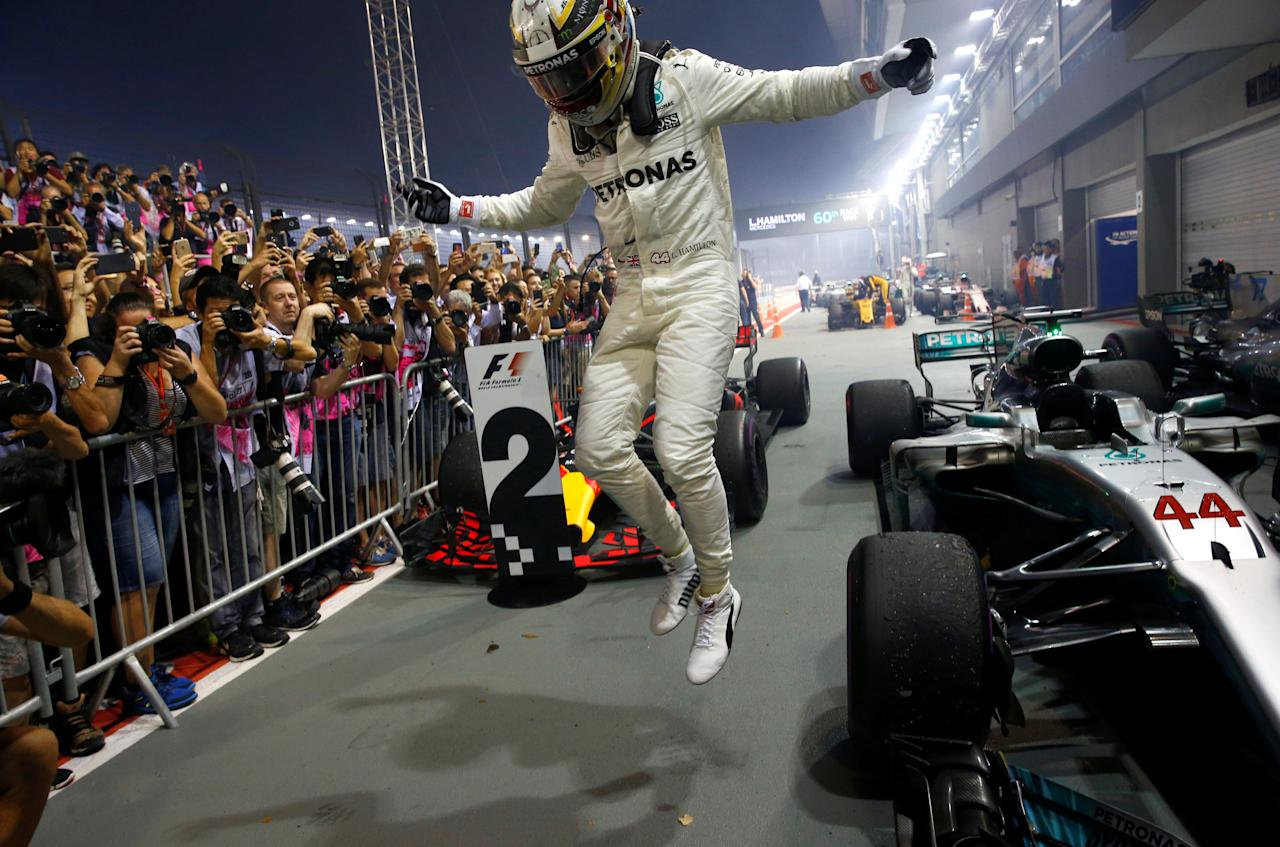 Formula One F1 - Singapore Grand Prix 2017 - Singapore - September 17, 2017 Mercedes' Lewis Hamilton celebrates winning the race REUTERS/Edgar Su
