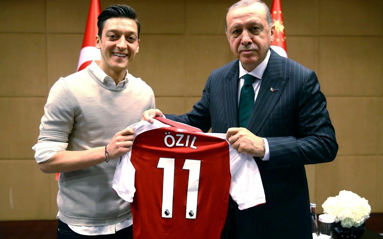 Football stars Mesut Özil (pictured, left) and Ilkay Gündogan posed with the Turkish president in London on Sunday May 13 - Pool Presdential Press Service