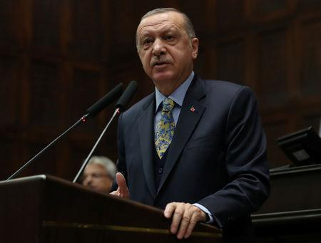 FILE PHOTO - Turkish President Tayyip Erdogan addresses members of parliament from his ruling AK Party (AKP) during a meeting at the Turkish parliament in Ankara, Turkey, January 15, 2019. REUTERS/Umit Bektas