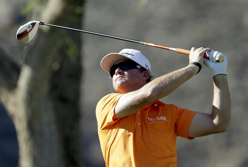 Brian Gay hits from the tee on the 14th hole during the final round of the Humana Challenge golf tournament on the Palmer Private course at PGA West in La Quinta, Calif., Sunday, Jan. 20, 2013. Gay defeated Charles Howell III on the second playoff hole to win the tournament. (AP Photo/Chris Carlson)