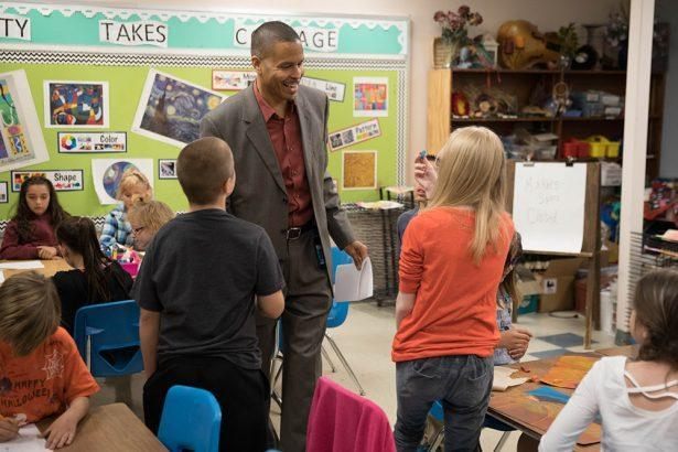 Michael Thomas speaks to students while visiting a school. (Colorado Springs School District 11)