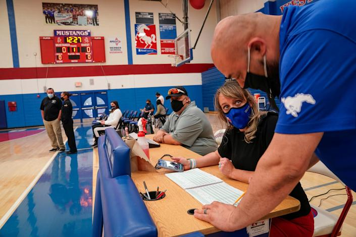 Stephanie Davy oversees the gymnasium during a girls basketball game. West Mesa hosted Piedra Vista High School, from Farmington, N.M.