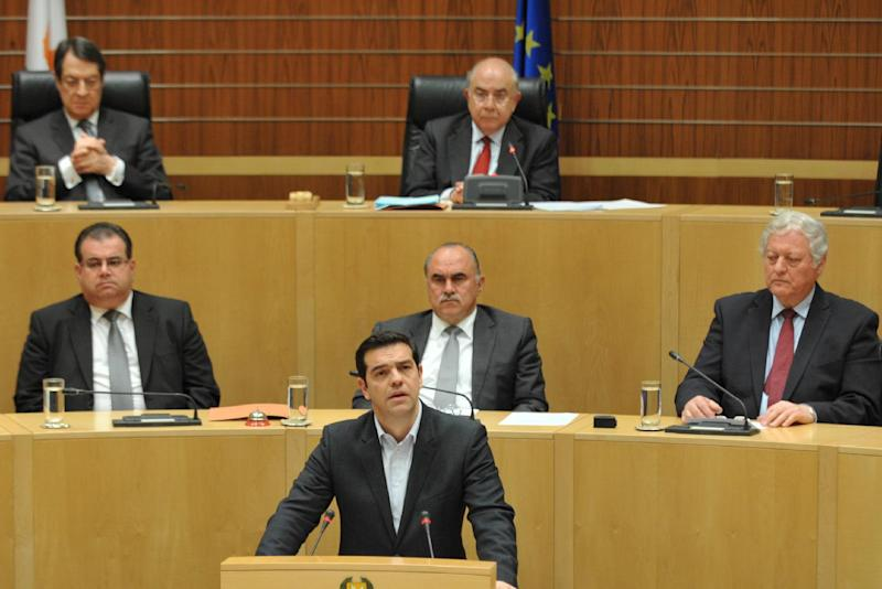 Greece's new Prime Minister Alexis Tsipras (C-bottom) addresses a special session of the Cypriot House of Representatives on February 2, 2015 at the parliament in Nicosia (AFP Photo/Maria Christodoulou)