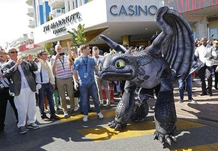 "A figure of Toothless the Dragon character walks on the Croisette during a photocall for the film ""How to Train Your Dragon 2"" at the 67th Cannes Film Festival in Cannes May 15, 2014. REUTERS/Yves Herman"
