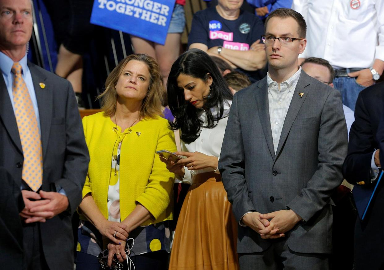 Hillary Clinton's director of communications, Jennifer Palmieri; longtime aide Huma Abedin,; and campaign manager Robby Mook at a campaign rally in Portsmouth, N.H. (Photo: Brian Snyder/Reuters)