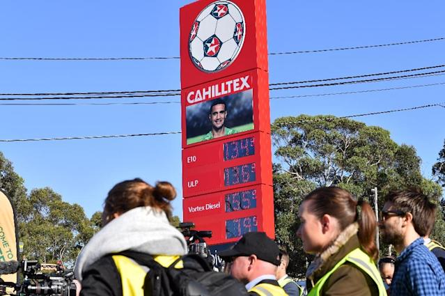 Australia's Socceroos key sponsor Caltex displays veteran Tim Cahill's picture as new advertising campaign at the company's petrol station in Sydney on May 15, 2018. Australian football chiefs were forced to deny that veteran Tim Cahill was in the country's World Cup squad for commerical reasons after in-form Hibernian striker Jamie Maclaren was axed. (AFP Photo/Saeed KHAN)