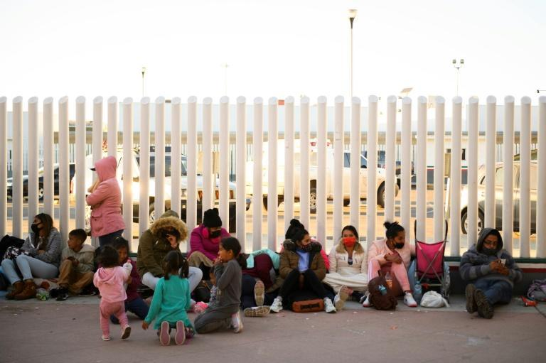 Asylum seekers wait outside the El Chaparral border crossing in Tijuana, Mexico hoping to be able to cross into the United States