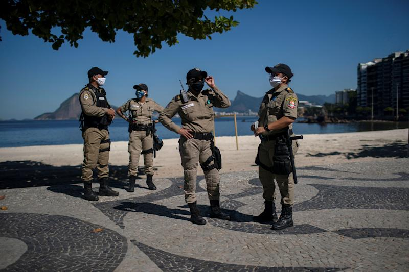 Municipal guards patrol the promenade of Icarai beach during the first day of lockdown due to the COVID-19 coronavirus, in Niteroi, Rio de Janeiro state, Brazil, on May 11, 2020. - Brazil, the hardest-hit Latin American country in the coronavirus pandemic, has surpassed 10,000 deaths, according to figures released last weekend by the Ministry of Health. (Photo by Mauro Pimentel / AFP) (Photo by MAURO PIMENTEL/AFP via Getty Images)