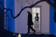 President Joe Biden walks on the Colonnade to Marine One for departure from the South Lawn of the White House, Friday, Feb. 12, 2021, in Washington. Biden is en route to Camp David. (AP Photo/Alex Brandon)