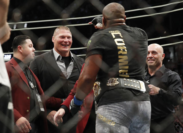 Brock Lesnar, second from left, taunts Daniel Cormier, second from right, after Cormier's heavyweight title mixed martial arts bout at against Stipe Miocic at UFC 226, Saturday, July 7, 2018, in Las Vegas. (AP Photo/John Locher)