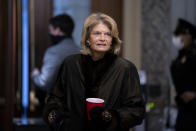 Sen. Lisa Murkowski, R-Alaska, arrives at the start of the fifth day of the second impeachment trial of former President Trump, Saturday, Feb. 13, 2021 at the Capitol in Washington. (Stefani Reynolds/Pool via AP)