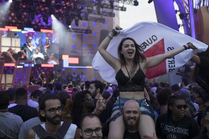 A music fan cheers during the performance of the Brazilian band Raimundos at the Rock in Rio music festival in Rio de Janeiro, Brazil, Sunday, Sept. 24, 2017. (AP Photo/Leo Correa)