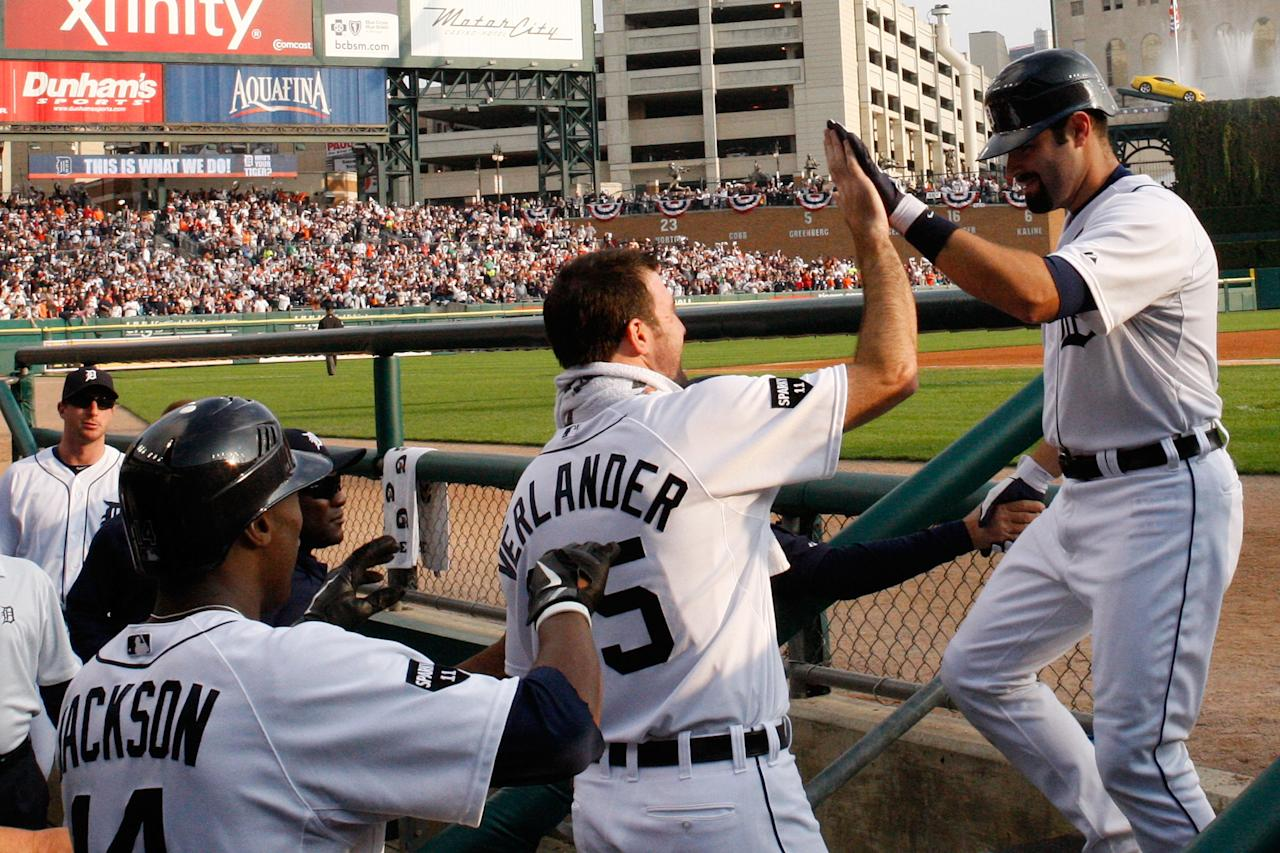 DETROIT, MI - OCTOBER 13:  Alex Avila #13 of the Detroit Tigers celebrates in the dugout with Justin Verlander #36 after hitting a solo home run in the third inning of Game Five of the American League Championship Series against the Texas Rangers at Comerica Park on October 13, 2011 in Detroit, Michigan.  (Photo by Harry How/Getty Images)