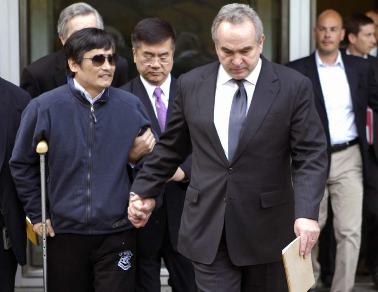 In this photo released by the US Embassy Beijing Press Office, blind lawyer Chen Guangcheng, left, is helped by U.S. Assistant Secretary of State for East Asia and Pacific Affairs Kurt Campbell, right, and U.S. Ambassador to China Gary Locke as they leave the U.S. Embassy for a hospital in Beijing Wednesday May 2, 2012. (AP Photo/US Embassy Beijing Press Office, HO)