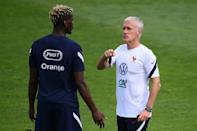 France coach Didier Deschamps (R) talks to Paul Pogba as they look to add the European Championship title to the World Cup they won in Russia in 2018