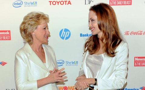 Tina Brown with Angelina Jolie in New York at the Women in the World Summit 2012 - Credit: AP/Evan Agostini