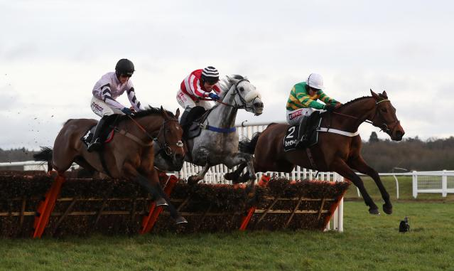 Eventual winner Champ ridden by Barry Geraghty (right) jumps the last with Kateson and Getaway Trump