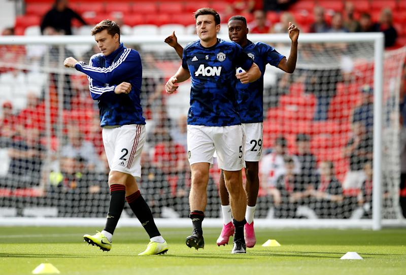 Manchester United's Victor Lindelof (left to right), Harry Maguire and Aaron Wan-Bissaka warm-up before the Premier League match at Old Trafford, Manchester. (Photo by Martin Rickett/PA Images via Getty Images)