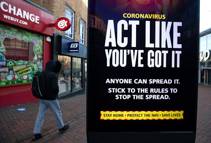 A person passes a 'Act like you've got it' government coronavirus sign on Commercial road in Bournemouth, during England's third national lockdown to curb the spread of coronavirus. Picture date: Friday January 22, 2021. (Photo by Andrew Matthews/PA Images via Getty Images)