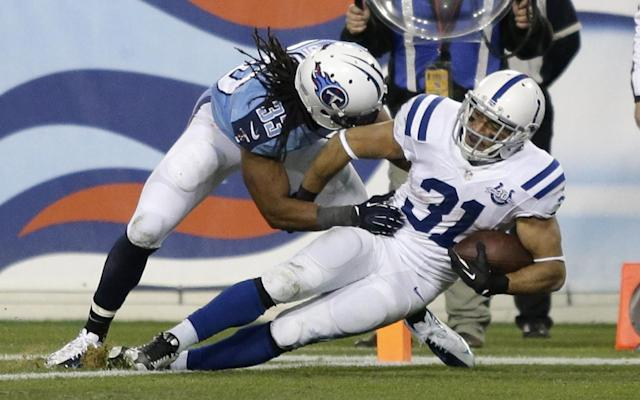 Indianapolis Colts running back Donald Brown (31) scores a touchdown as Tennessee Titans safety Michael Griffin (33) defends during the third quarter of an NFL football game Thursday, Nov. 14, 2013, in Nashville, Tenn. (AP Photo/Wade Payne)