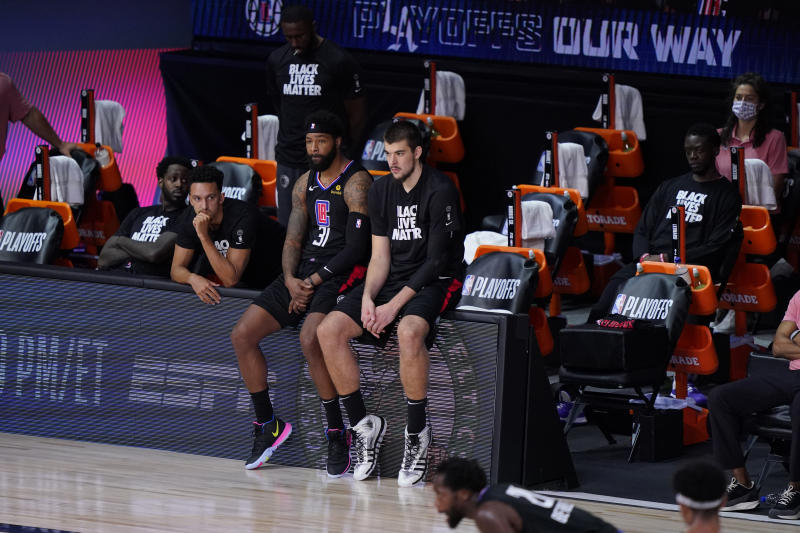 The Los Angeles Clippers players sit on the bench during the second half as they fall to the Denver Nuggets in an NBA conference semifinal playoff basketball game Tuesday, Sept. 15, 2020, in Lake Buena Vista, Fla. (AP Photo/Mark J. Terrill)