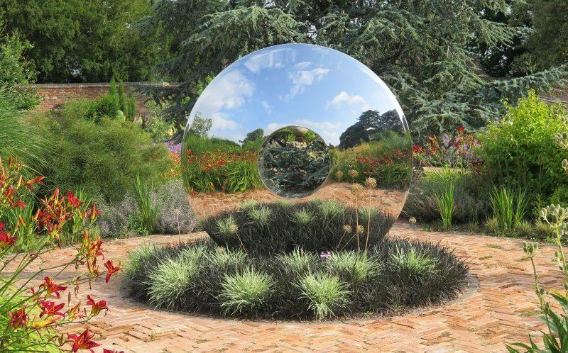 Two halves: guests can explore interesting and modern artwork at this beautifully presented garden in Gloucestershire - National Garden Scheme