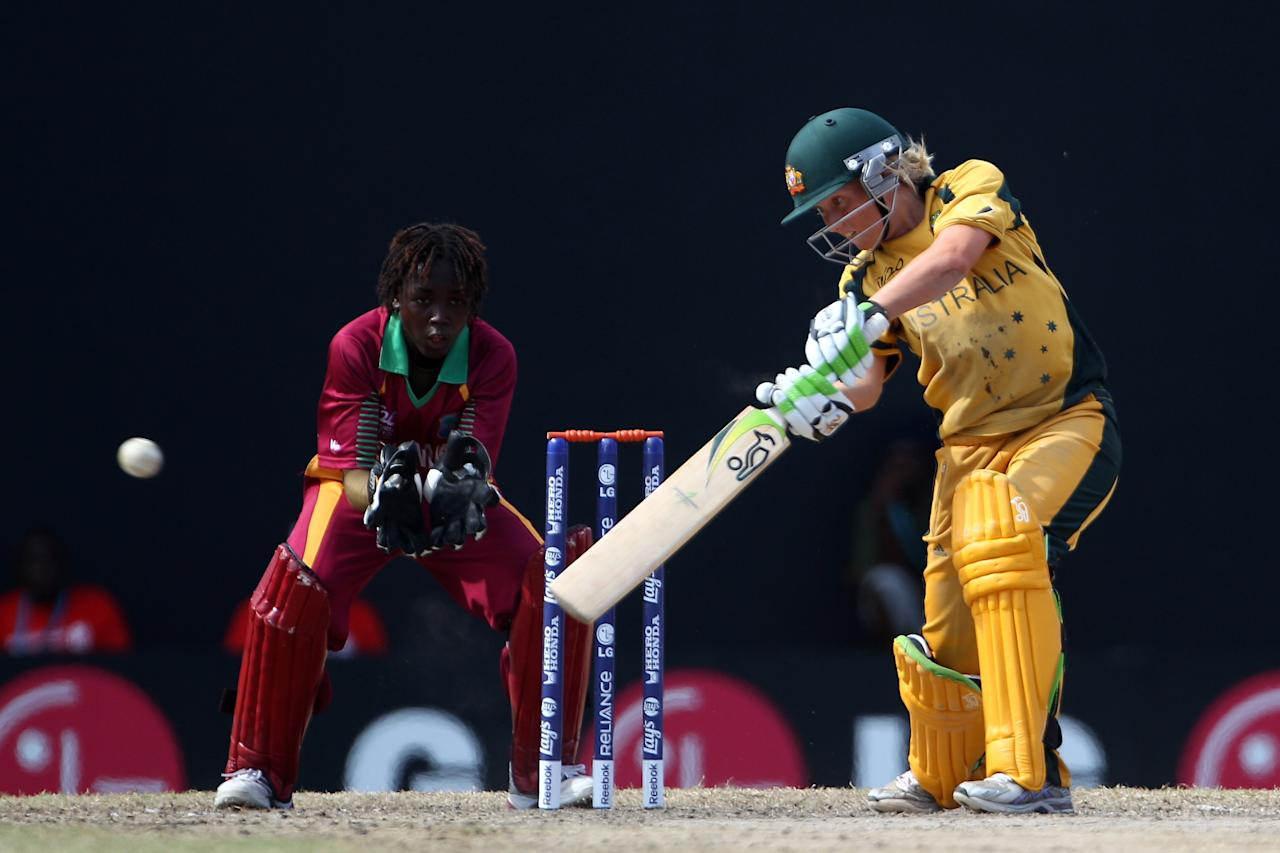 ST KITTS, SAINT KITTS AND NEVIS - MAY 09:  Alyssa Healy of Australia hits to the offside as Shemaine Campbelle looks on during the ICC T20 Women's World Cup Group A match between Australia and West Indies at Warner Park on May 9, 2010 in St Kitts, Saint Kitts And Nevis.  (Photo by Michael Steele/Getty Images)