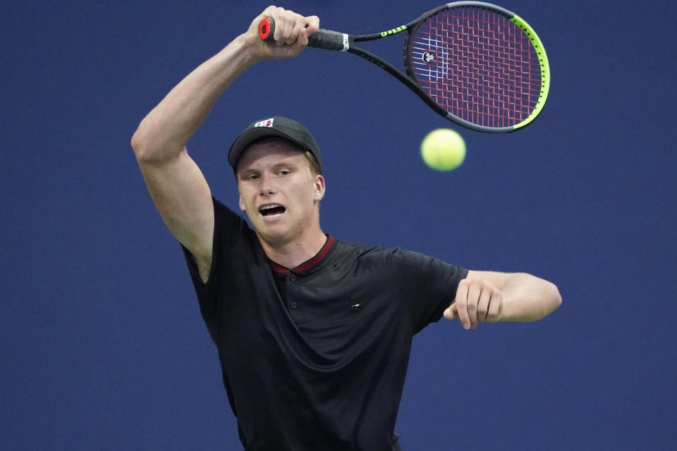 Jenson Brooksby, of the United States, returns the ball during the first round of the US Open tennis championships, Tuesday, Aug. 31, 2021, in New York. (AP Photo/Elise Amendola)
