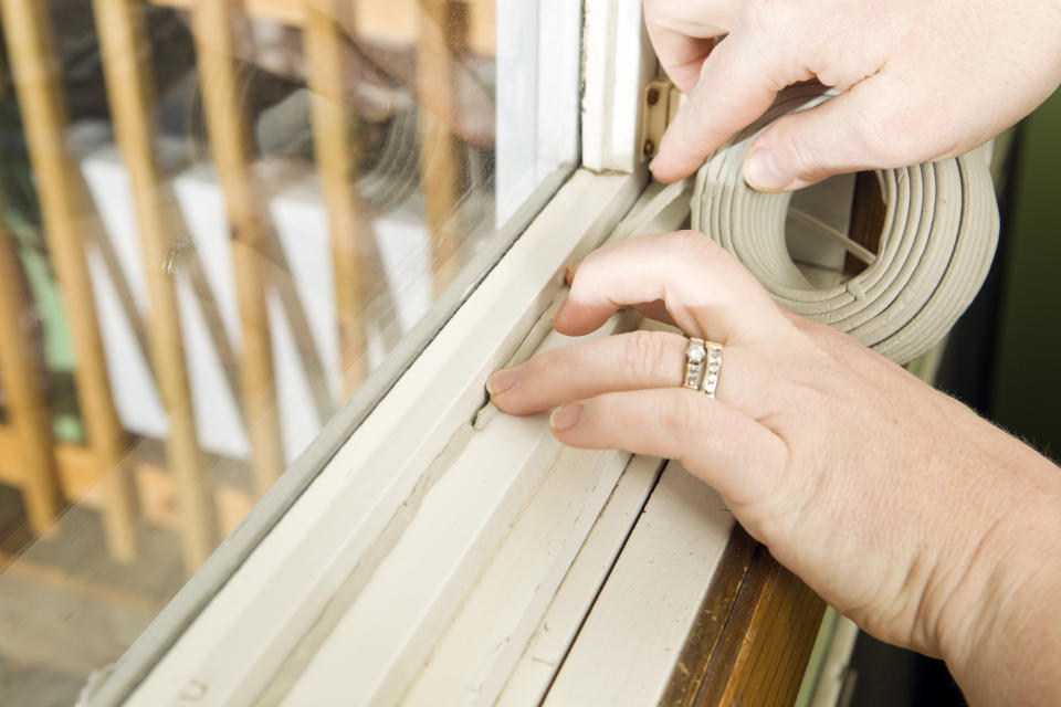 """<p>""""Weatherizing"""" your home means adding weatherstripping to your doors and windows to minimize air leaks. Every case is different, so you'll want to do a little research on what type of weatherstripping is best suited to your needs. <a href=""""https://www.canadiantire.ca/en/pdp/polar-bear-foam-tape-0378913p.html?utm_source=vrz&utm_medium=display&utm_campaign=10009368_21_CTS_JNJ_FALL&utm_content=10009368_21_CTS_JNJ_FALL_EN_VRZ_CONS_TR_CAN_UTM_1x1_Comfortable%20Home"""" rel=""""nofollow noopener"""" target=""""_blank"""" data-ylk=""""slk:Polar Bear Foam Tape"""" class=""""link rapid-noclick-resp"""">Polar Bear Foam Tape</a>, for instance, has a self-adhesive backing for easy installation. Not only will your home feel more comfortable without the elements invading your space, you'll also save money on your heating and cooling costs.</p>"""