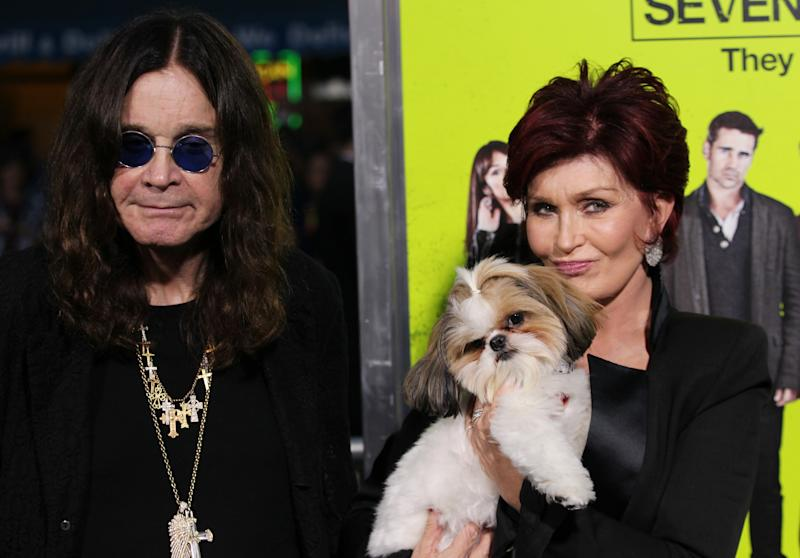 "Ozzy Osbourne, left, and Sharon Osbourne, right pose with Bonny the dog at the premiere of ""Seven Psychopaths"" at the Bruin Theatre on Monday, Oct. 1, 2012 in Los Angeles. (Photo by Matt Sayles/Invision/AP)"