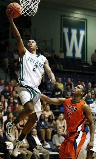 Tulane guard Ricky Tarrant (2) scores over UTEP guard C.J. Cooper (5) during the first half of an NCAA college basketball game in New Orleans, Saturday, Jan. 21, 2012. (AP Photo/Jonathan Bachman)