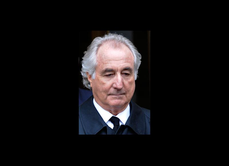 FILE - In this March 10, 2009 file photo, Bernard Madoff exits Manhattan federal court in New York. On Thursday, Aug. 8, 2013, prosecutors in New York filed papers in federal court seeking to have evidence of romantic and sexual relationships excluded from the upcoming trial of some of the Ponzi king's subordinates. Prosecutors claim that that four of five defendants and several government witnesses were at times seeing each other romantically or were sexually involved with one another and one defendant was in a love triangle with Madoff himself. (AP Photo/Louis Lanzano, File)