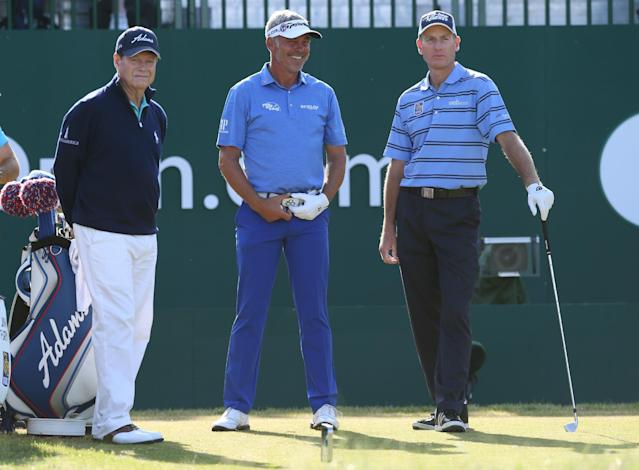 Tom Watson of the US, left, Darren Clarke of Northern Ireland and Jim Furyk of the US, right, talk on the 1st tee box during the first day of the British Open Golf championship at the Royal Liverpool golf club, Hoylake, England, Thursday July 17, 2014. (AP Photo/Jon Super)