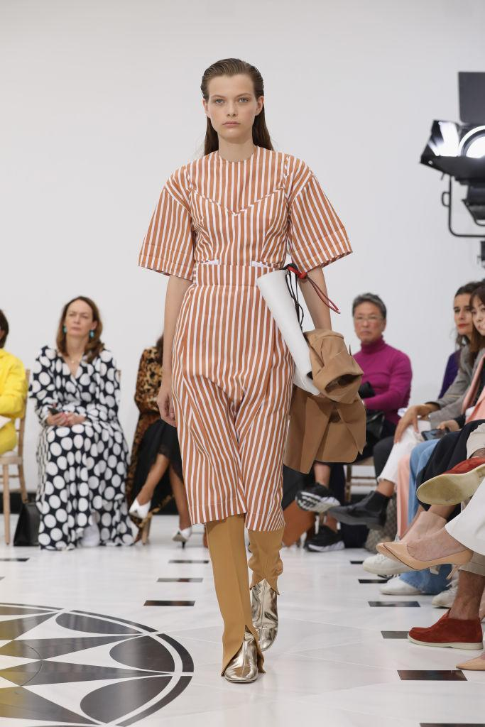 Victoria Beckham designed a collection for every woman on the go, as models graced the runway with a tailored coat and heavy duty clutch in the crook of their arm [Photo: Getty]