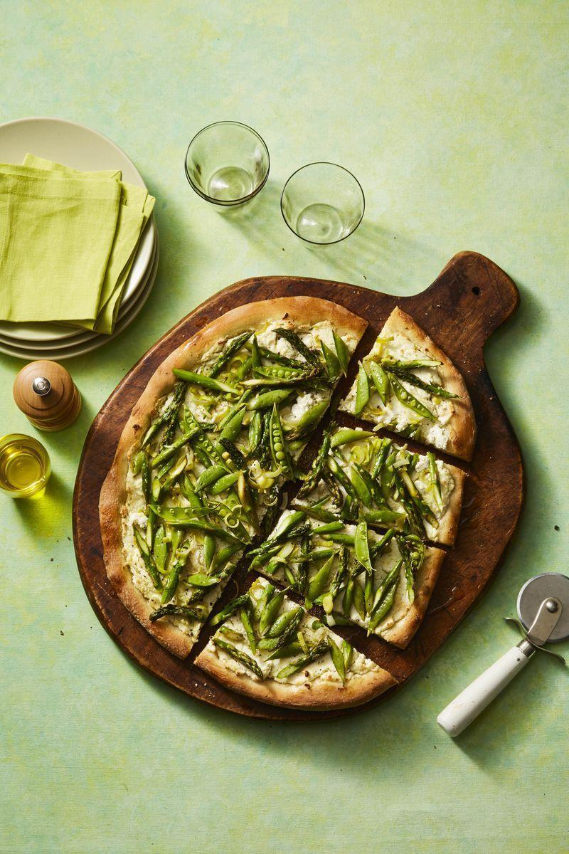 """<p>Whether you serve it as an app or a main dish, this spring vegetable pizza will not disappoint.</p><p><a href=""""https://www.womansday.com/food-recipes/food-drinks/a26729638/spring-vegetable-pizza-recipe/"""" rel=""""nofollow noopener"""" target=""""_blank"""" data-ylk=""""slk:Get the recipe for Spring Vegetable Pizza."""" class=""""link rapid-noclick-resp""""><em>Get the recipe for Spring Vegetable Pizza.</em></a></p>"""