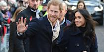 <p>The pair attended the Terrence Higgins Trust World AIDS Day charity fair in Nottingham, England, in what appeared to be matching outerwear ensembles. The former <em>Suits</em> actress dressed to impress in a full-length navy double-breasted coat, while Harry sported a similarly colored blazer. Markle softly smiled at Harry as he greeted the crowd.</p>