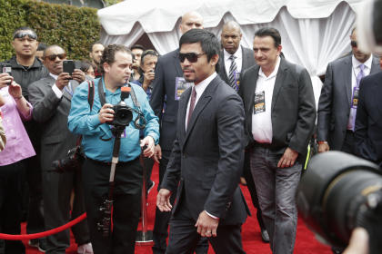 Manny Pacquiao arrives for a news conference in Los Angeles on Wednesday. (AP Photo/Jae C. Hong)