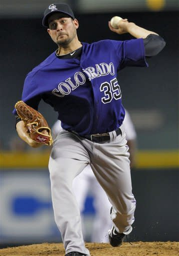 Colorado Rockies pitcher Jonathon Sanchez delivers against the Arizona Diamondbacks during the second inning of a baseball game, Monday, July 23, 2012, in Phoenix. (AP Photo/Matt York)
