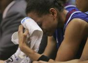 Kansas guard Angel Goodrich sheds a tear in the final minutes of her team's loss to Notre Dame at a regional semi-final of the NCAA college basketball tournament Sunday March 31, 2013, in Norfolk, Va. Notre Dame won 93-63. (AP Photo/Jason Hirschfeld)
