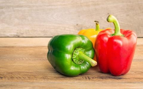 Bell pepper green, red and yellow on wooden background - Credit: Atit Phetmuangtong/EyeEm/Getty Images