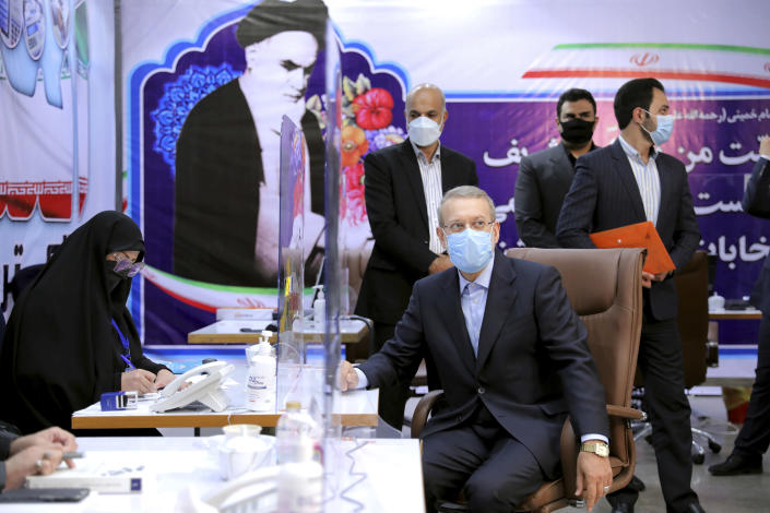 Former Iranian parliament speaker Ali Larijani, front right, registers his name as a candidate for the June 18 presidential elections at the interior Ministry in Tehran, Iran, Saturday, May 15, 2021.(AP Photo/Ebrahim Noroozi)