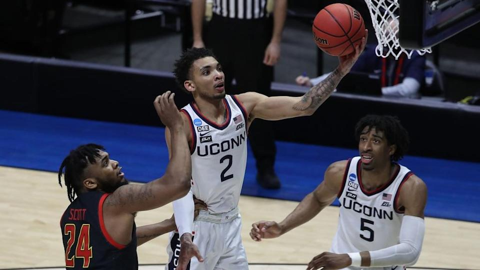 Mar 20, 2021; West Lafayette, Indiana, USA; Connecticut Huskies guard James Bouknight (2) shoots the ball over Maryland Terrapins forward Donta Scott (24) as Connecticut forward Isaiah Whaley (5) looks on during the second half in the first round of the 2021 NCAA Tournament at Mackey Arena.