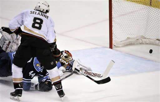 Anaheim Ducks' Teemu Selanne (8) scores against Florida Panthers goalie Jose Theodore (60) during the first period of an NHL hockey game on Sunday, Feb. 19, 2012, in Sunrise, Fla. (AP Photo/Gary I Rothstein)