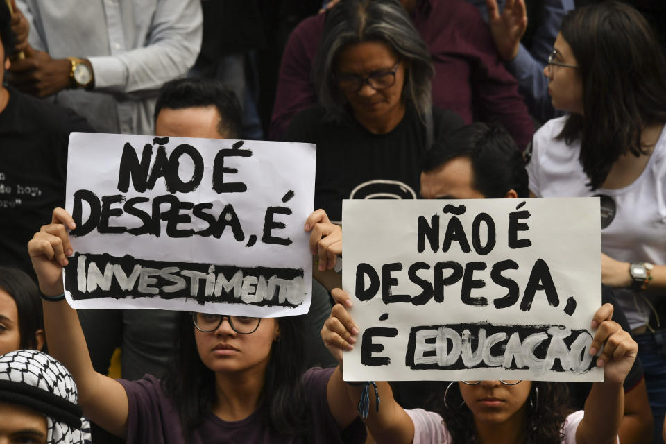 People demonstrate during a strike organized by the National Students Union (UNE) in Sao Paulo, Brazil on May 15, 2019. - Students and teachers from hundreds of universities and colleges across Brazil began a nationwide demonstration on Wednesday in 'defense of education' following a raft of budget cuts announced by President Jair Bolsonaro's government. (Photo by NELSON ALMEIDA / AFP)        (Photo credit should read NELSON ALMEIDA/AFP/Getty Images)