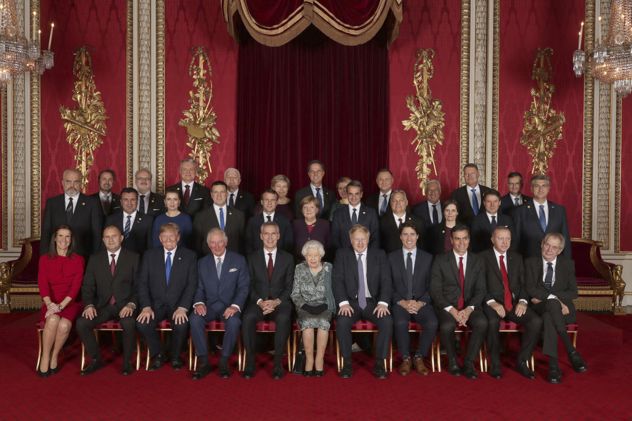 Leaders of the NATO alliance countries, and its secretary general, join Britain's Queen Elizabeth II and Prince Charles the Prince of Wales, for a group picture during a reception at Buckingham Palace in London, Tuesday Dec. 3, 2019, as they gathered to mark 70-years of the alliance. Back row, from left: Xavier Bettel Prime Minister of Luxembourg; Egils Levits President of Latvia; Gitanas Nauseda President of Lithuania; Dusko Markovic Prime Minister of Montenegro; Erna Solberg Prime Minister of Norway; Mark Rutte Prime Minister of Netherlands; Zuzana Caputova President of Slovakia; Andrzej Duda President of Poland; Antonio Costa Prime Minister of Portugal; Klaus Iohannis President of Romania; Marjan Sarec Prime Minister of Slovenia. Middle row from left: Edi Rama Prime Minister of Albania; Zoran Zaev Prime Minister of North Macedonia; Mette Frederiksen Prime Minister of Denmark; Juri Ratas Prime Minister of Estonia; Emmanuel Macron President of France; Angela Merkel President of Germany; Kyriakos Mitsotakis Prime Minister of Greece; Viktor Orban Prime Minister of Hungary; Katrin Jakobsdottir Prime Minister of Iceland; Giuseppe Conte Prime Minister of Italy; Andrej Plenkovic Prime Minister of Croatia. Seated from left: Sophie Wilmas Prime Minister of Belgium; Rumen Radev President of Bulgaria; Donald Trump President of United States; Prince Charles The Prince of Wales; Jens Stoltenberg NATO Secretary General; Queen Elizabeth II; Boris Johnson Prime Minister of the United Kingdom; Justin Trudeau Prime Minister of Canada; Pedro Sanchez Acting Prime Minister of Spain; Recep Tayyip Erdogan President of Turkey; Milos Zeman President of the Czech Republic. (Yui Mok/Pool via AP)