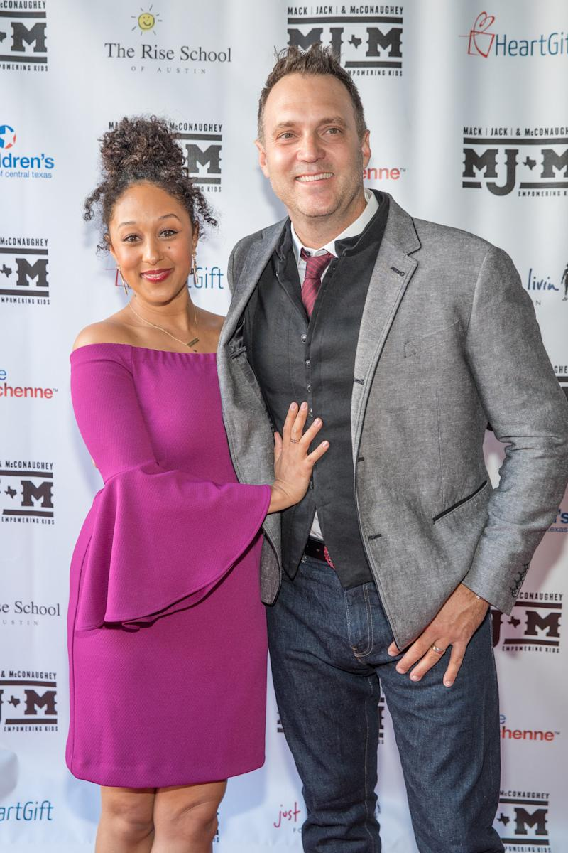 Tamera Mowry-Housley and husband Adam Housley pictured together.  (Rick Kern via Getty Images)