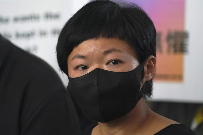 Hong Kong journalist Choy Yuk-ling, also known as Bao Choy, speaks to media outside a court in Hong Kong Thursday, April 22, 2021. The journalist has been found guilty of making false statements in obtaining information for an investigation into an attack on anti-government protesters, in the latest blow to press freedom in the city as authorities continue their crackdown on dissent. (AP Photo/Kin Cheung)