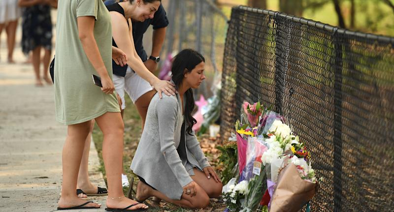 Leila Geagea at a makeshift memorial where three of her children were killed by a four-wheel-drive in Oatlands, Sydney.
