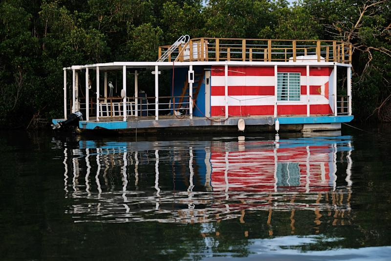 A house boat is seen secured to a mangrove as Tropical Storm Dorian approaches Cabo Rojo, Puerto Rico on Aug. 27, 2019. (Photo: Ricardo Arduengo/Reuters)